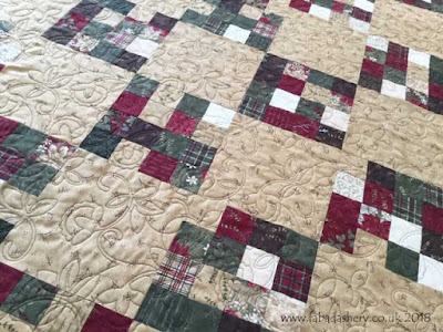 Lesley's Christmas Jelly Roll Quilt