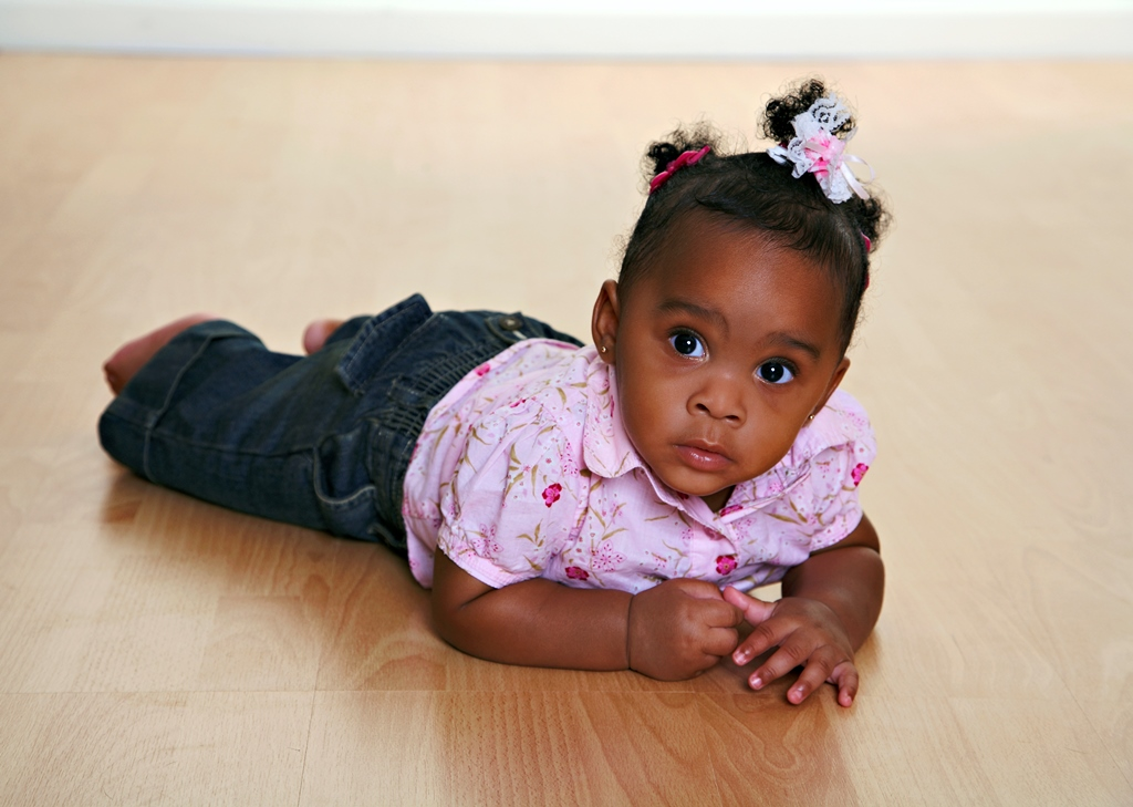 namc studying montessori today lillard ch 2 primary years. young girl crawling on floor
