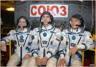 Crew members of the Soyuz MS-01 mission pose for pictures inside the integration facility at the Baikonur Cosmodrome in Kazakhstan (left to right) Kate Rubins of NASA, Anatoly Ivanishin of Roskosmos and Takuya Onishi of Japanese aerospace agency, JAXA.