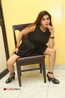Tollywood Upcoming Actress Pooja Roshan Stills in Black Short Dress at Plus 1 Movie Trailer Launch  0308.JPG