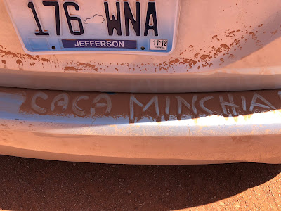 An invented Italian swear word written in the dust on the back of our van on the Valley Drive in Monument Valley.