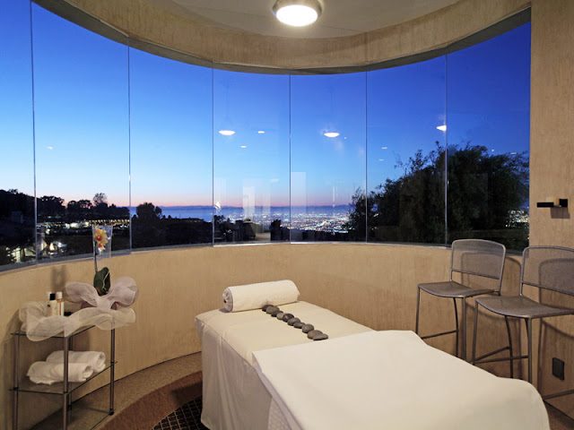 Photo of massage room with massage table and incredible views of Los Angeles