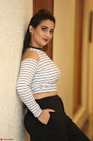 Manjusha in sleevelss crop top and black skirt at Darshakudu pre release ~  Exclusive Celebrities Galleries 040.JPG