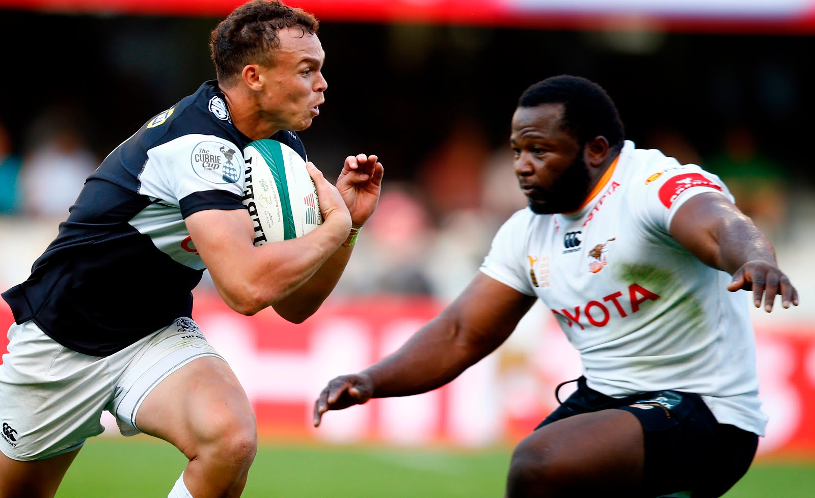 Ox Nche of the Free State Cheetahs looks to tackle Curwin Bosch of the Cell C Sharks during the Currie Cup match between the Cell C Sharks and the Free State Cheetahs at Jonsson Kings Park Stadium in Durban, South Africa 10th August 2019