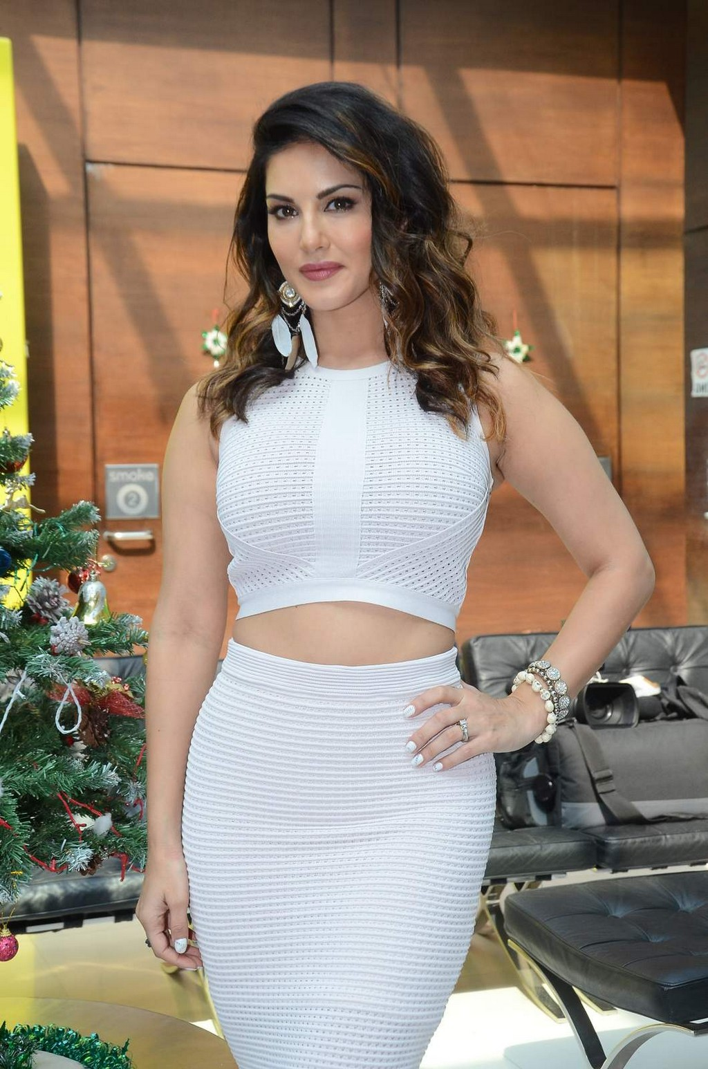 Bollywood Actress Sunny Leone Hot Legs Thigh Show Photos In White Dress