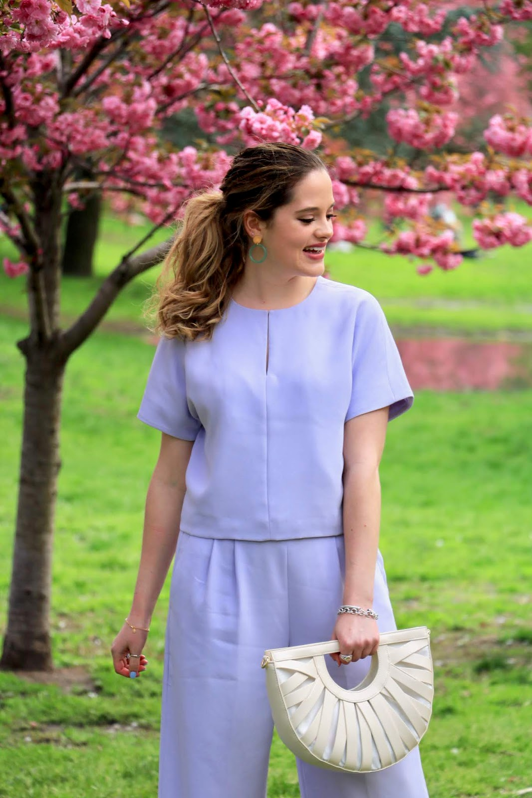 Nyc fashion blogger Kathleen Harper in Central Park with the cherry blossoms