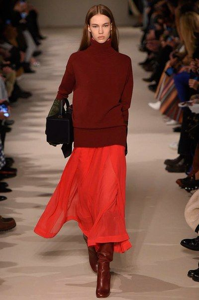 woman in burgundy turtleneck and boots and a long red skirt