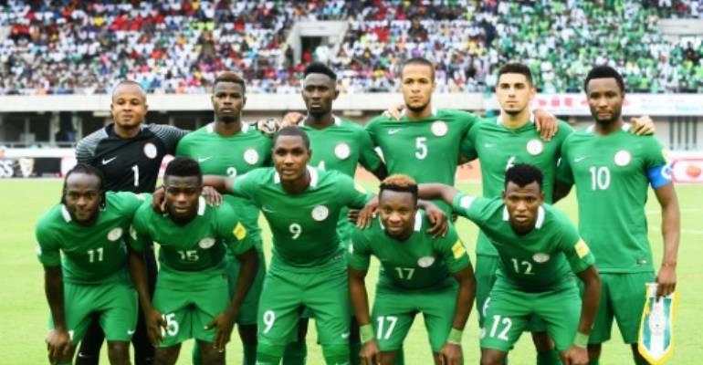 Nigeria's national football team players pose prior to their 2018 FIFA World Cup qualifying match against Cameroon, at Godswill Akpabio International Stadium in Uyo, on September 1, 2017. By PIUS UTOMI EKPEI (AFP/File)
