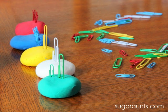 Picking up paper clips from a flat surface is a great way to work on fine motor skills.