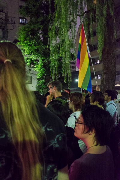 An LGBT crowd listens to speakers at the end of the commemorative candlelight vigil and march for Orlando shooting victims, Hanazononishi Koen Park, Shinjuku, Tokyo.