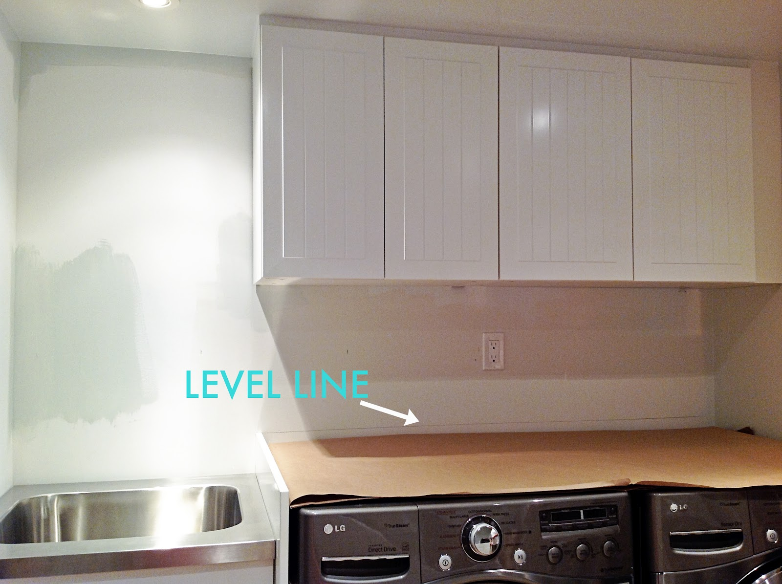 How To Install A Countertop Over A Washer And Dryer, DIY floating countertop in the laundry room, countertop cleat, counter over front load washer and dryer