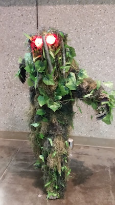 A cosplayer/costumer dressed as Marvel's Man-Thing.