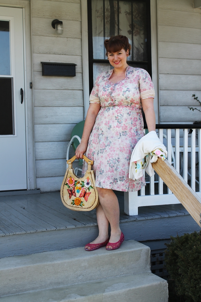 1940's pink sheer sweetheart dress with victory rolls