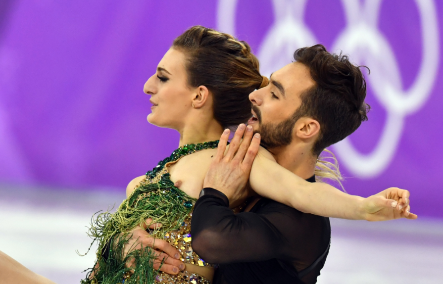 The pair were still able to finish as Papadakis tried in vain to keep her chest covered.