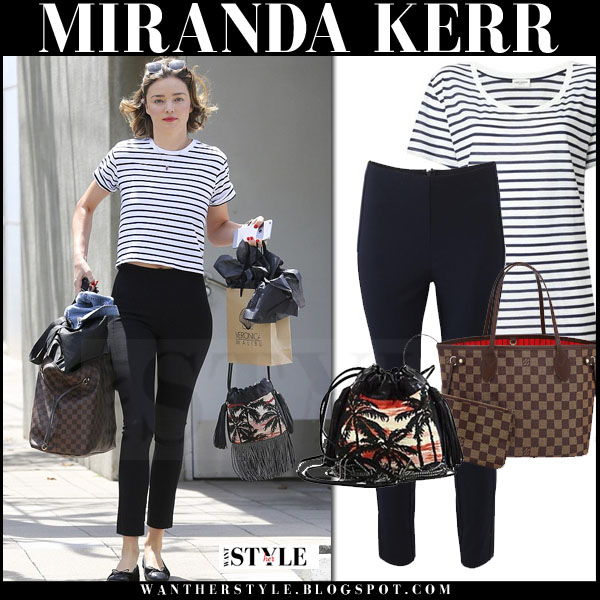 Miranda Kerr in striped saint laurent navy t-shrit, black cropped rag bone simone pants and palm print saint laurent helena bucket bag what she wore model style