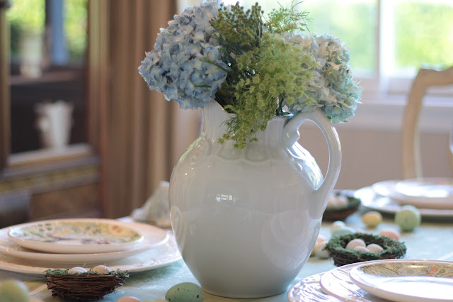 classic easter tablescape white pitcher blue green flowers simple centerpiece