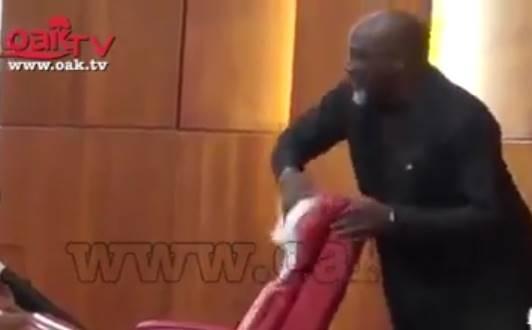 Dino Melaye uses handkerchief to clean 'Juju' from Saraki's seat (Photos/video)