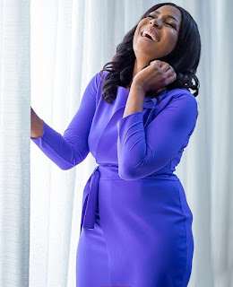 Linda Ikeji shows off her style credentials in a purple dress