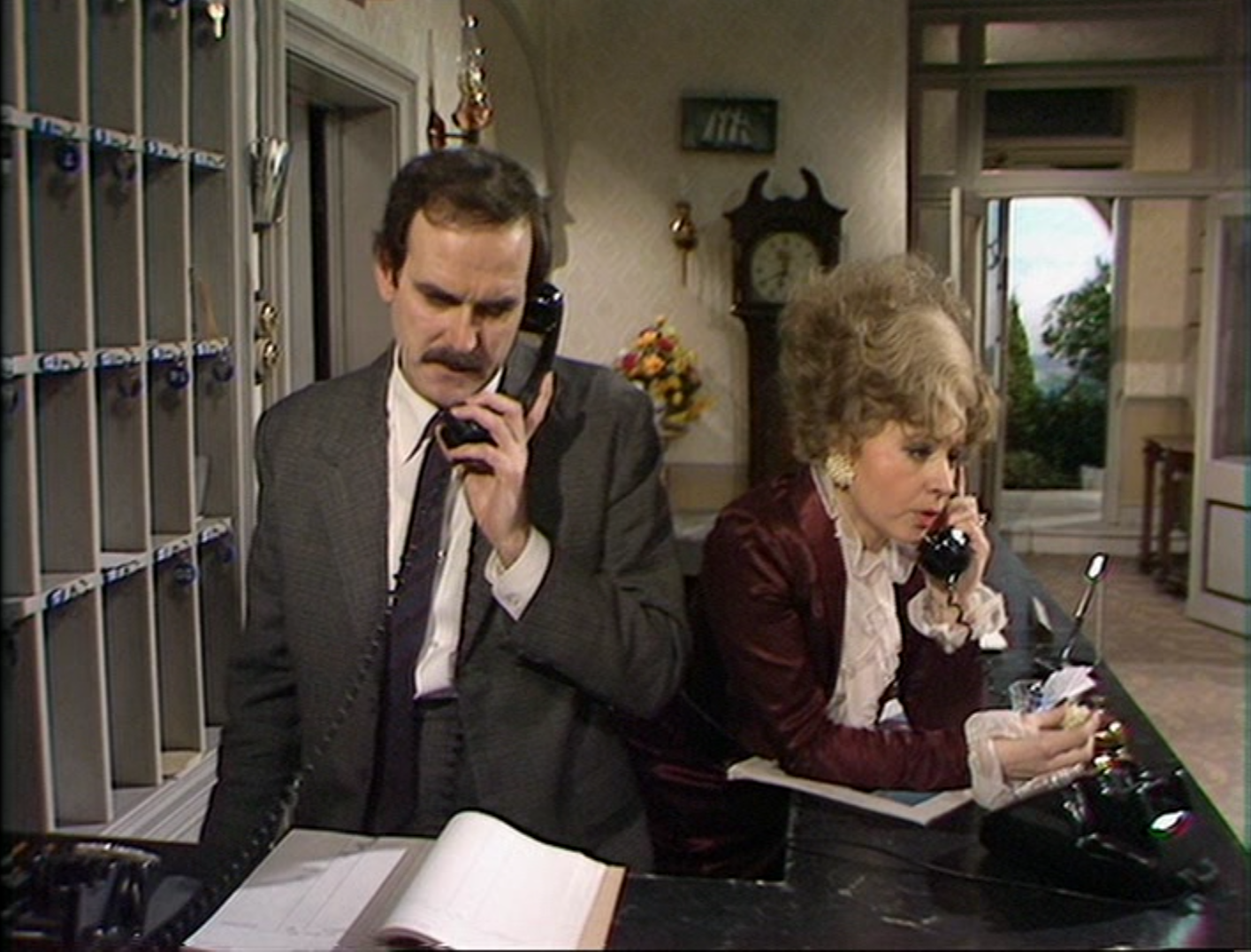 hotel customer service - Basil & Sybil Fawlty in a scene from Fawlty Towers