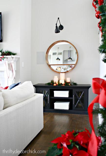 Black cabinet round mirror