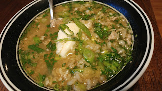 Soft Rice Soup with ginger, green onions, eggs poached in broth, ground pork, cilantro