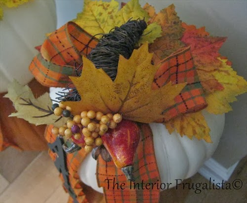 Attach a Fall Pick to the top of the pumpkin.