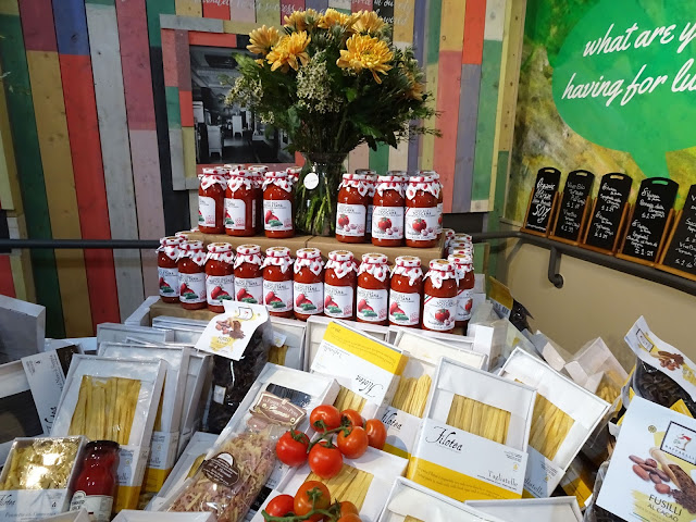 Display of various types of pasta and sauces