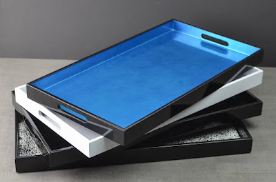 stack of 4 lacquer trays; top one is black exterior, blue interior