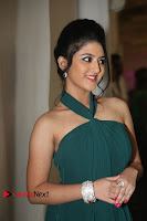 Shriya Sharma Green sleeveless shoulder less Backless tight Gown at Nirmala Convent Audio Launch