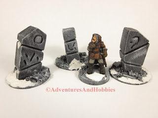 Group of three stone monuments for Frostgrave 25-28 mm scale terrain - front view.