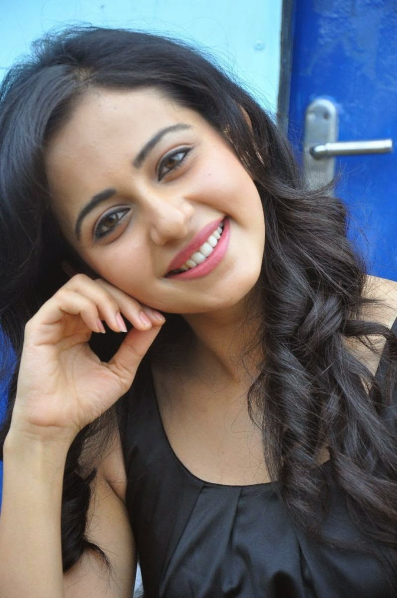 Rakul Preet Singh Cute Smiling Face Close Up Stills In Black Dress