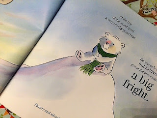 Inside the book, showing the bear sitting on a snowy hill