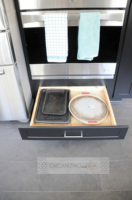 Cookie sheet drawer under double oven :: OrganizingMadeFun.com