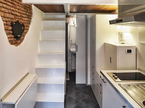 05-Kitchen-Dining-Stairs-Bed-and-Toilet-Door-Smallest-House-in-Italy-75-sq-Feet-7-m2-Italian-Architect-Marco-Pierazzi-www-designstack-co