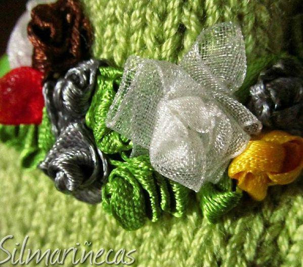 flores de lazo en chaqueta tricotada 2x1