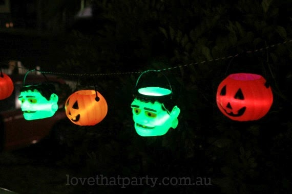 glow in the dark halloween garland with pumpkins and monsters and glow sticks