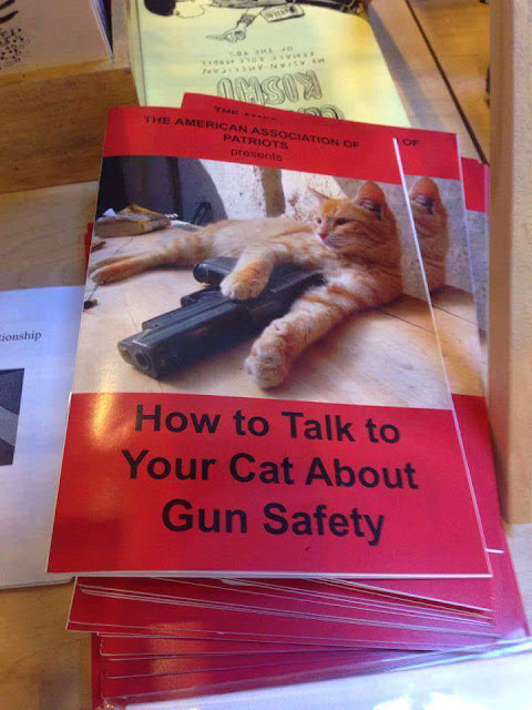 Funny booklet picture - How to talk to your cat about gun safety