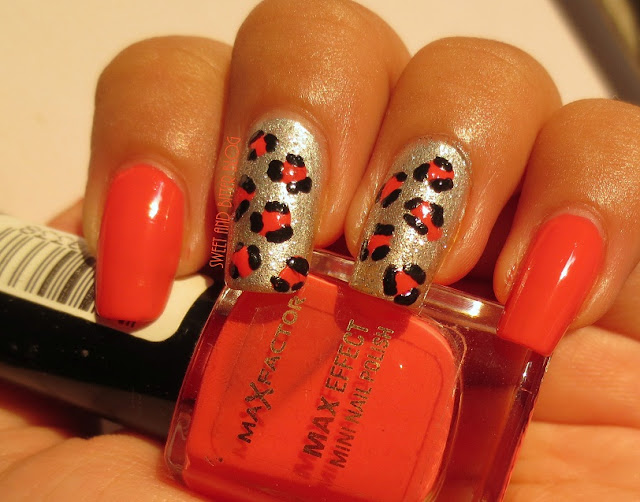 Animal Print Nail Art with Coral, Silver, and Black using Dots