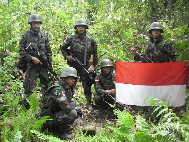 TNI Patroli Pengamanan Patok Perbatasan RI-PNG
