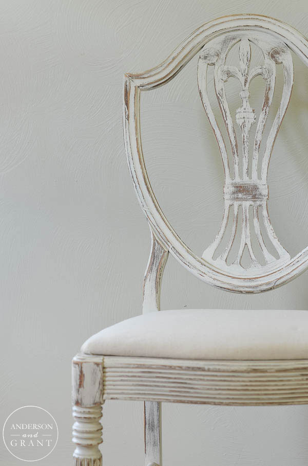 Antique dining room chair painted white with drop cloth seat.  |  www.andersonandgrant.com