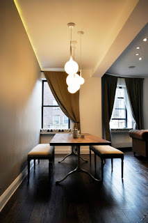 Bright Bubble Lamps above the Wooden Dining Sets With Benches and Hardwood Floor near Glass Windows