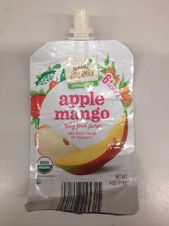 An empty pouch of Little Journey Organics Apple Mango Baby Food Puree, from Aldi