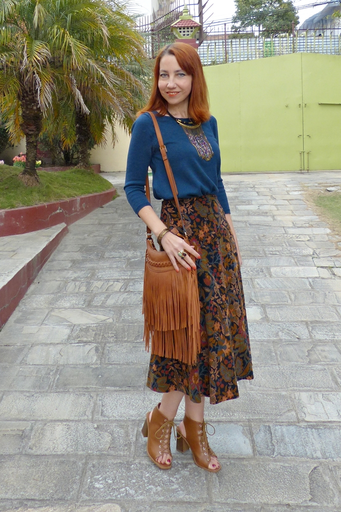 Patterned corduroy skirt with knit top and fringed bag
