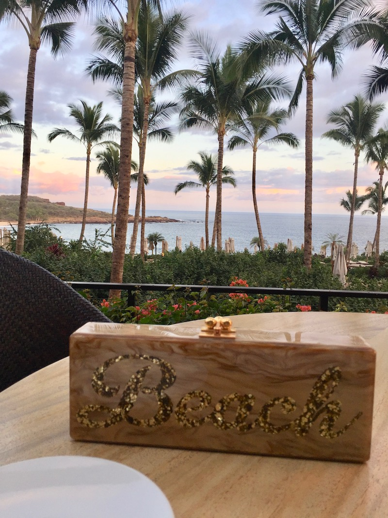Edie Parker beach clutch at Four Seasons Lanai