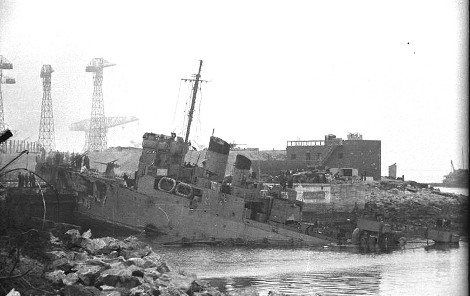 The British destroyer HMS Campbeltown sits destroyed, wedged into the dock gates of Normandie dry dock at St. Nazaire in German-occupied France, on March 28, 1942. Members of the Royal Navy and British Commandos carried out an amphibious raid on the docks earlier that day, attempting to prevent the Germans from possessing such a valuable asset. The Campbeltown was packed with with delayed-action explosives, which later detonated, killing more than 300 Germans and knocking the dock out of commission.