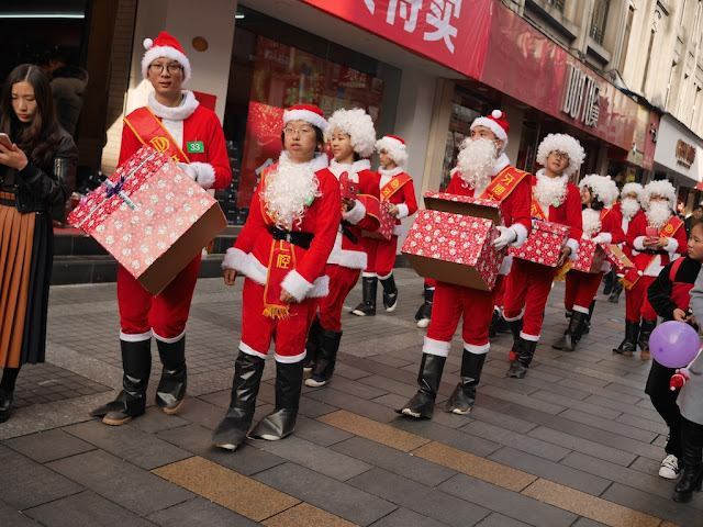 man more Santas in Wenzhou