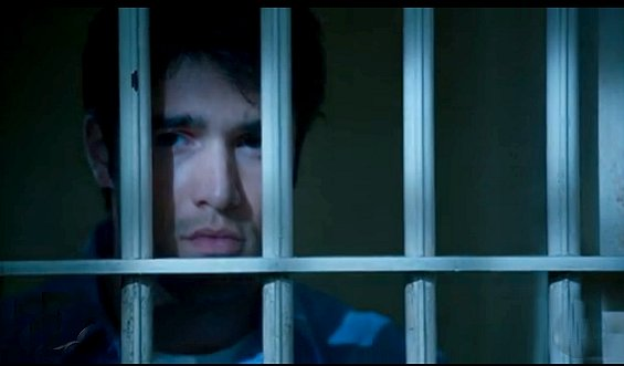 Revenge - Daniel close shot of his face as he stands behind bars