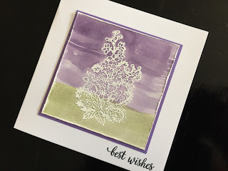 Hand made birthday card with water color background and emboss resist larkspur