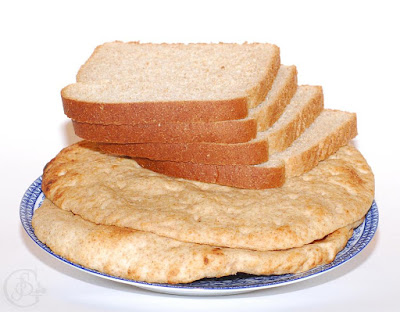 Two types of whole wheat products - sliced bread and pitas.