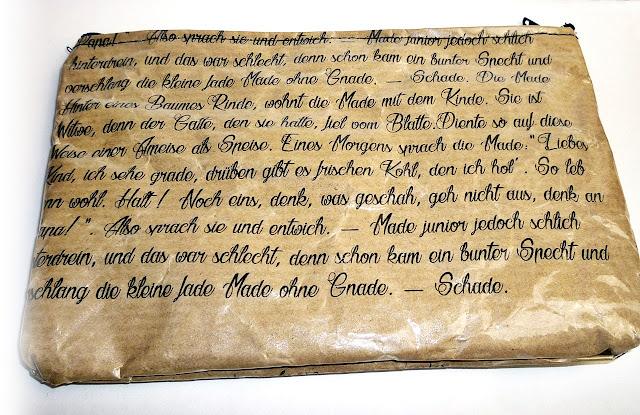 Mäppchen aus Papier genäht, mit Gedicht bedruckt